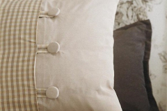 Cushion with contrast panel & centre buttons