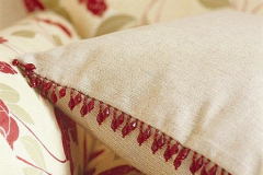 Cushion with beaded edge trim